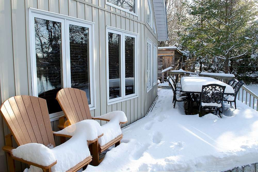 Snow covered deck & Hot tub around the corner